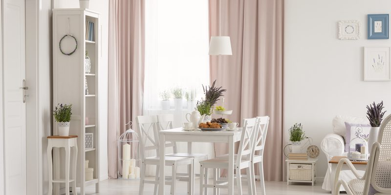 White furniture with pale pink curtains